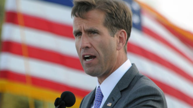 Delaware Attorney General Beau Biden delivers his commencement address at Dover High School's graduation ceremony Wednesday night, June 5, 2013.