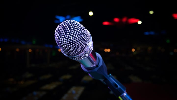 microphone stand on the stage venue with blur bokeh