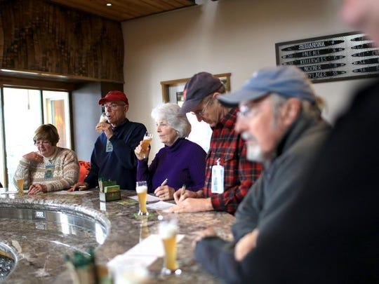 Guests sample beers at the end of a tour through the Sierra Nevada brewery in Mills River on Tuesday. The 90-minute tour leads guests through the 200-barrel brewhouse, giving a glimpse into the beer-making process and ending with a tasting of several Sierra Nevada beers. The brewery hosts free tours several times daily, with prior reservations required.