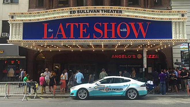 The Ben & Jerry's Tesla Model S makes an appearance in front of the Ed Sullivan Theater.