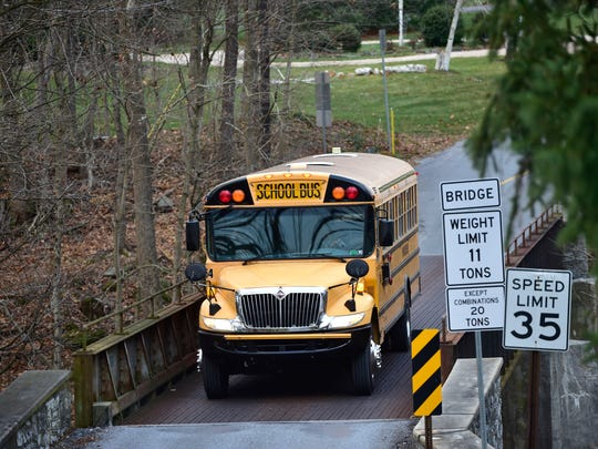 A school bus crosses the Heisey Road bridge in Montgomery Township, Thursday, Dec. 3, 2015. the bridge that takes traffic over the Conococheague Creek. Federal money has been set aside to repair structurally deficient bridges throughout the state.