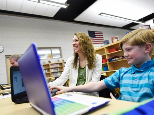 Irene Ondrasik of Jacobus, left, follows along during a workshop designed to teach her about her son, 11-year-old Jeremiah Ondrasik's Chromebook at Dallastown Intermediate School. All sixth-graders at the school are issued a Chromebook, and students in fourth and fifth grades use Chromebooks during the day.