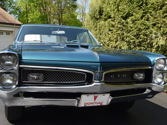 A 1967 Pontiac GTO, one of the cars Kenny Pascoe has collected.