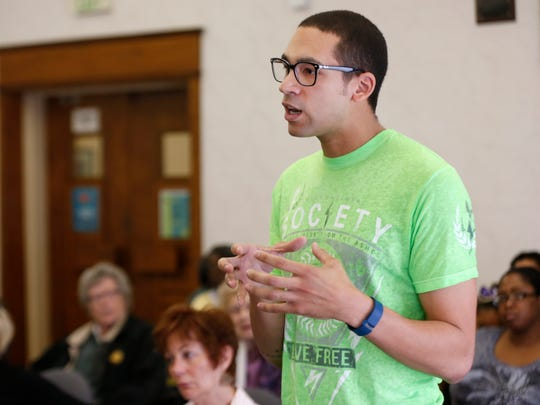 Austin Boyland asks a question of the Springfield school board candidates during a NAACP forum at the Midtown Carnegie Library on Saturday, Mar. 19, 2016.