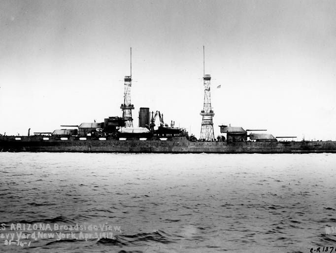 THEN: A broadside view of the USS Arizona is seen in