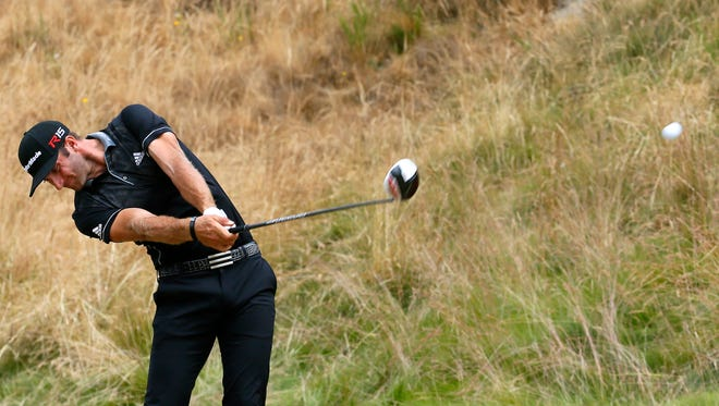 Dustin Johnson hits his tee shot on the eighth hole during the first round of the U.S. Open golf tournament at Chambers Bay on Thursday, June 18, 2015 in University Place, Wash.