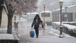 Pedestrian braves the first snow of the season in Hackensack.