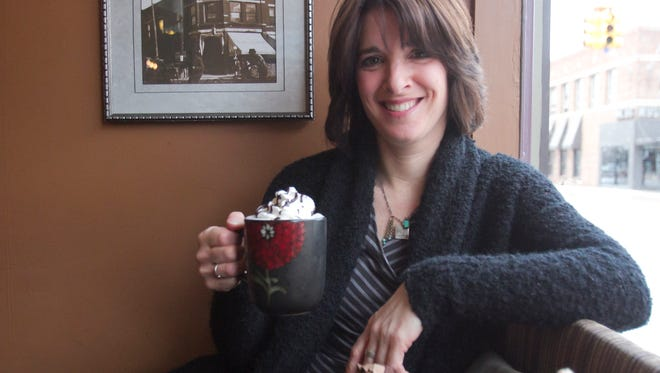 Relaxing with a cup of English toffee mocha, Uptown Coffeehouse owner Lorna Brennan doesn't often rest on her laurels despite the downtown Howell coffee shop being named one of the best in the country.
