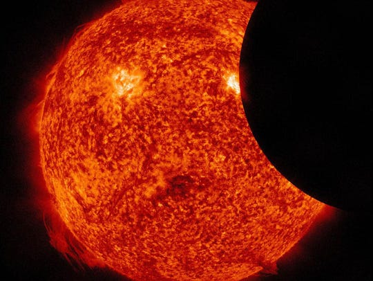 A solar eclipse captured by the Solar Dynamics Observatory.
