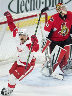 Senators goalie Craig Anderson looks at the scoreboard as the Red Wings' Tomas Tatar celebrates his game-winning goal during overtime Monday. The Red Wings won 4-3.