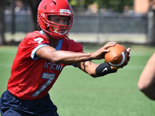 Hirschi quarterback Martez Vrana takes a snap during Oil Bowl practice Wednesday at Midwestern State University.