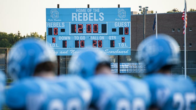 The South Burlington Rebels football team gathers on the sidelines at the start of a game against CVU in South Burlington on Sep. 4.