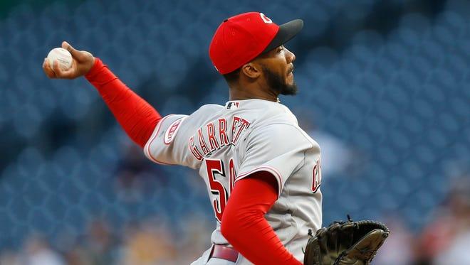 Cincinnati Reds starting pitcher Amir Garrett throws against the Pittsburgh Pirates in the first inning.