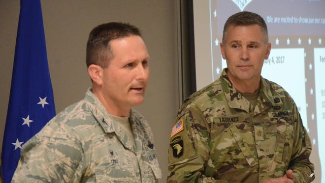 Colonel Bryan Teff, commander of the Air National Guard Base, left, and Major Frank Laurence, deputy commander of the Fort Custer Training Center.