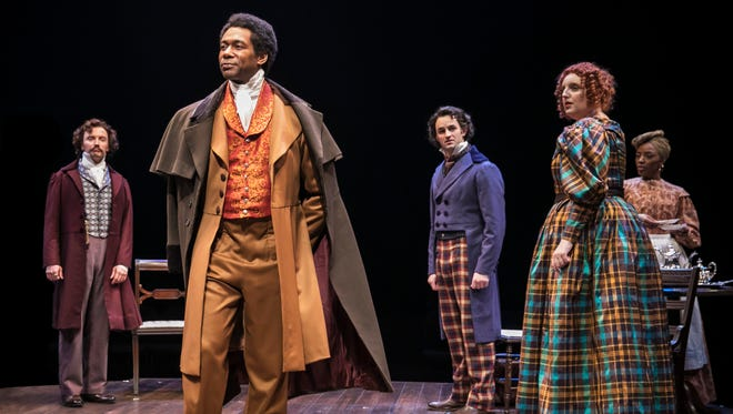 """Ira Aldridge (Dion Johnstone, at center) shocks company members when he is announced to replace leading actor Edmund Kean in the title role of Othello in Chicago Shakespeare Theater's production of """"Red Velvet."""""""