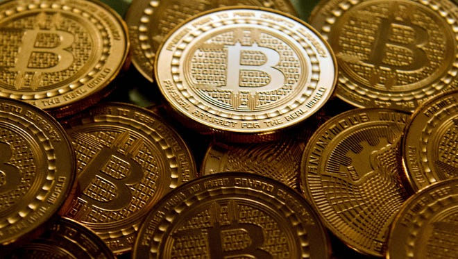 This file photo taken in Washington, D.C., on May 1, 2014, shows bitcoin medals.