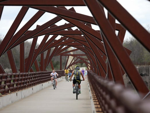 Bikers and hikers cross the High Trestle Trail near