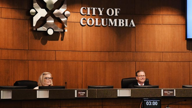 First Ward City Councilwoman Pat Fowler and Mayor Brian Treese listen to a resident's public comments during a City Council meeting Monday night.