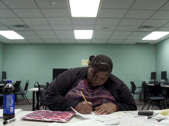 "A student does her assignments at the Excel Center in Indianapolic. The film ""Night School"" will be shown at the Mariner in Marine City."