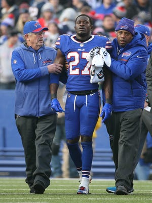 Bills rookie Tre'Dazious White is taken off the field after a late hit by Patriots Rob Gronkowski.