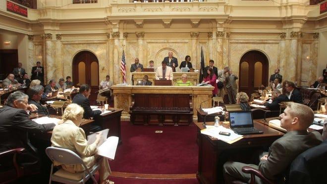 Senators vote on bills in this June 2012 file photo. (Augusto F. Menezes/Staff photographer)