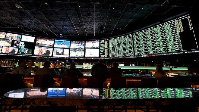 LAS VEGAS, NV - FEBRUARY 02:  The betting line and some of the nearly 400 proposition bets for Super Bowl 50 between the Carolina Panthers and the Denver Broncos are displayed at the Race & Sports SuperBook at the Westgate Las Vegas Resort & Casino on February 2, 2016 in Las Vegas, Nevada. The newly renovated sports book has the world's largest indoor LED video wall with 4,488 square feet of HD video screens measuring 240 feet wide and 20 feet tall.  (Photo by Ethan Miller/Getty Images)