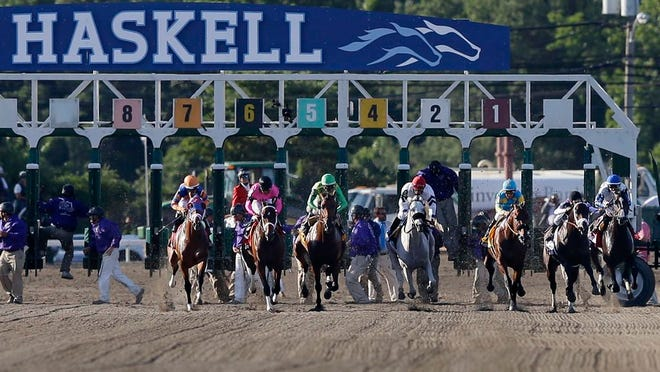 The horses leave the starting gate during the Haskell Invitational horse race at Monmouth Park in Oceanport, N.J., Sunday, Aug. 2, 2015. Jockey Victor Espinoza, third right, on Triple Crown winner American Pharoah won. Keen Ice  was second.
