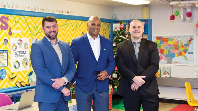 Boys and Girls Clubs of Central Ohio CEO Doug Wolf, left, community advocate Jordan Miller and Champion CEO Brian Yeager.