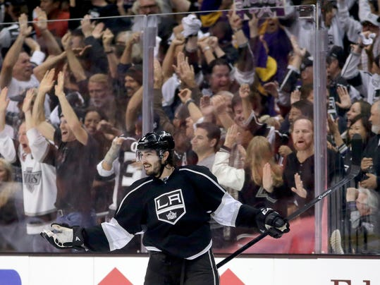 FILE - In this May 24, 2014, file photo, Los Angeles Kings defenseman Drew Doughty celebrates his goal against the Chicago Blackhawks during the third period of Game 3 of the Western Conference finals of the NHL hockey Stanley Cup playoffs in Los Angeles. Doughty once loved playing for the Los Angeles Kings because he could live unnoticed in a nonhockey town. But after two Olympic gold medals and a Stanley Cup title, the Kings' defenseman has lost his anonymity. Now he's intent on adding second ring during an electrifying postseason run. (AP Photo/Chris Carlson, File)