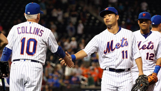 Sep 27, 2017; New York City, NY, USA; New York Mets manager Terry Collins (10) and right fielder Nori Aoki (11) shake hands after the Mets defeated the Atlanta Braves at Citi Field.