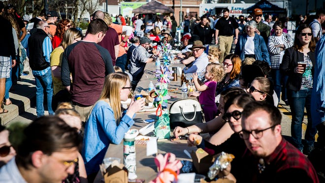 Hundreds of attendees enjoyed live music and food from local vendors while dining on the Washington Street Bridge during the second annual Muncie Bridge Dinner Thursday evening.