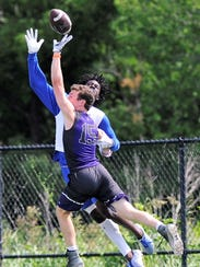 Wylie defensive back Jaden Speegle (15) breaks up a pass during the Bulldogs' 7-on-7 game Friday against Temple.