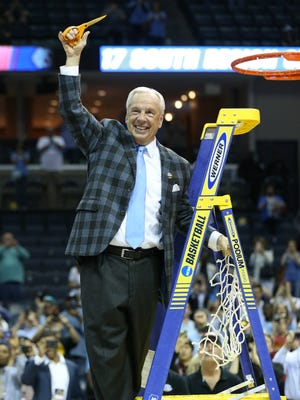 North Carolina Tar Heels head coach Roy Williams reacts after cutting down the nets after defeating the Kentucky Wildcats in the finals of the South Regional of the 2017 NCAA Tournament at FedExForum. North Carolina won 75-73.
