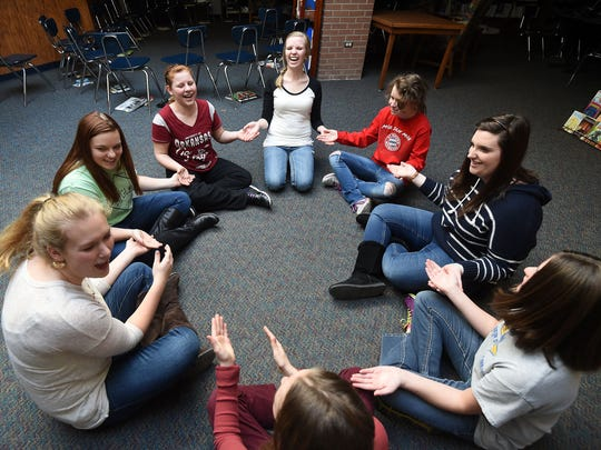 Mountain Home High School students and Pinkston Middle School students laugh while playing a game on Thursday. A number of high school girls are mentoring middle school girls as part of a new program called BigLil. Pictured are, from left, Kaylea Yeakley, 17, Linnsey Dunavan, 16, Autumn McFarland, 12, Rachel Bruton, 18, Madi Feeser, 12, Madeline Malloy, 17, Grace Avants, 13, and Mary Stupar, 13.