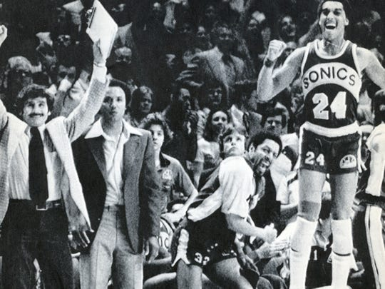 From left, SuperSonics assistant coach Les Habegger, head coach Lenny Wilkens, team captian Fred Brown and Dennis Johnson celebrate as their 1979 championship win over the Washington Bullets neared.  P-I file photo (Via MerlinFTP Drop)