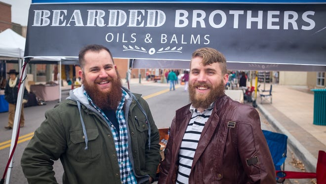 Joseph Quirico, left, and Tyler McFarland, the Bearded Brothers, at their booth in the Farmer's Market. Quirico and McFarland have known each other since the first grade and produce a line of oils and balms for beard care.