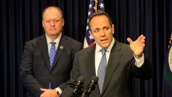 Kentucky Governor Matt Bevin introduces a state pension reform plan during a press conference at the Capitol. On left is Speaker of the House Jeff Hoover. Oct . 18, 2017.