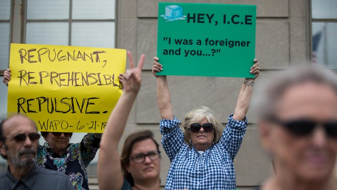 Protesters hold signs across from the U.S. Immigration and Custom Enforcement office in downtown Louisville condemning the handling of immigrant families. Over 200 attended a protest in downtown Louisville on Thursday. June 21, 2018