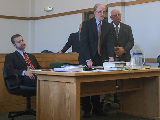 Sen. Norm McAllister, right, stands at the defense table next to lawyers David Williams, center, and Brooks McArthur before jury draw on Tuesday, June 14, 2016, in Vermont Superior Court in St. Albans.