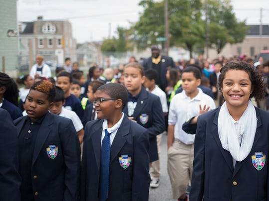 Nevaeh Williams, right, during the walk. Lincoln Charter School in York celebrates International Walk to School Day with a walk around the neighborhood and a pep rally promoting a safe and healthy lifestyle, Wednesday, October 7, 2015. Paul Chaplin - For the Daily Record/Sunday News