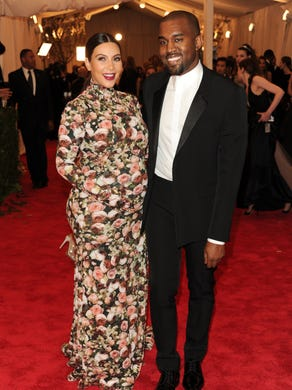 In this famous— or infamous— May 6, 2013 pic, West and Kardashian attend the Met Ball in New York, fashion's biggest night. She got major flack for her Givenchy dress.