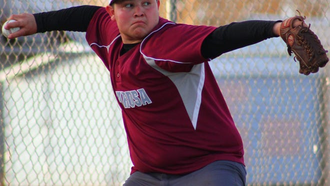 Tularosa's Andres Aragon prepares to throw a pitch during practice Thursday evening.