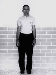 Full frontal shot of John Feit in 1960, who has long been the prime suspect in the murder of Irene Garza, a 25-year-old schoolteacher in McAllen.  Feit was 27 at the time and working as a Catholic priest at Ms. Garza's church, Sacred Heart, on the Easter weekend when she disappeared after going to confession.