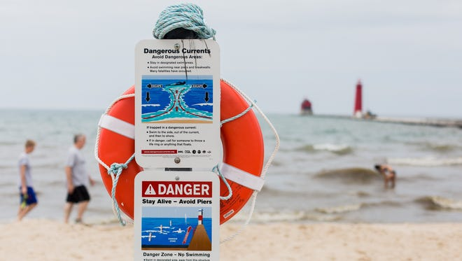 Signs at Grand Haven State Park in Grand Haven, Mich. on Thursday, June 15, 2017.