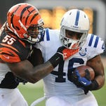 Colts tight end Dominique Jones gets smacked by Bengals linebacker Vontaze Burfict in the first half of Thursday night's game at Paul Brown Stadium in Cincinnati on Aug. 29, 2013. Matt Detrich / The Star