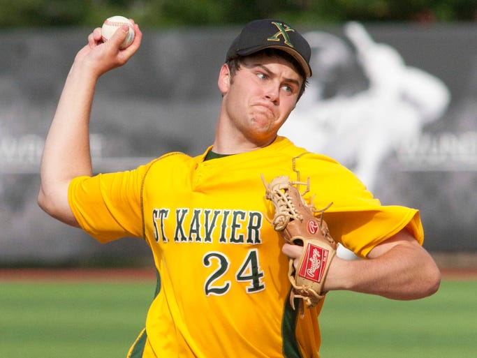 St. Xavier's starting pitcher Cameron Revelette throws in the championship game of the of the boys' 7th regional baseball tournament.  29 May 2014