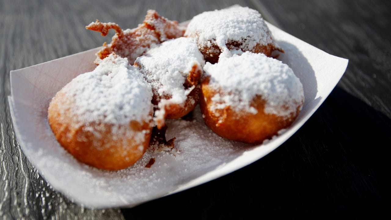 Food reporter Mackensy Lunsford tries fried treats at the NC Mountain State Fair in Fletcher.