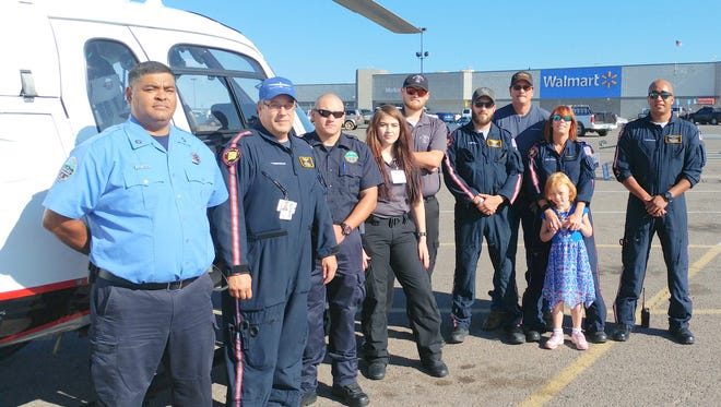 Pictured from Left to Right: Paul Ortiz - SCFD; Troy Lane - Native Air; Colton Allen - SCFD; Faviola Garcia - GRMC EMS; Jacob Herring - GRMC EMS; Michael Starr - Native Air; Travis Schull - Native Air; Cindy Kulikowski and her Daughter Dillon - Native Air; and Anthony Murillo - Native Air