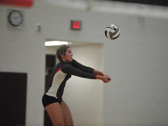 Jenna Karl sets one of her teammates in the third game