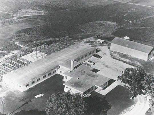 This 1952 aerial photo shows East Central's barn and